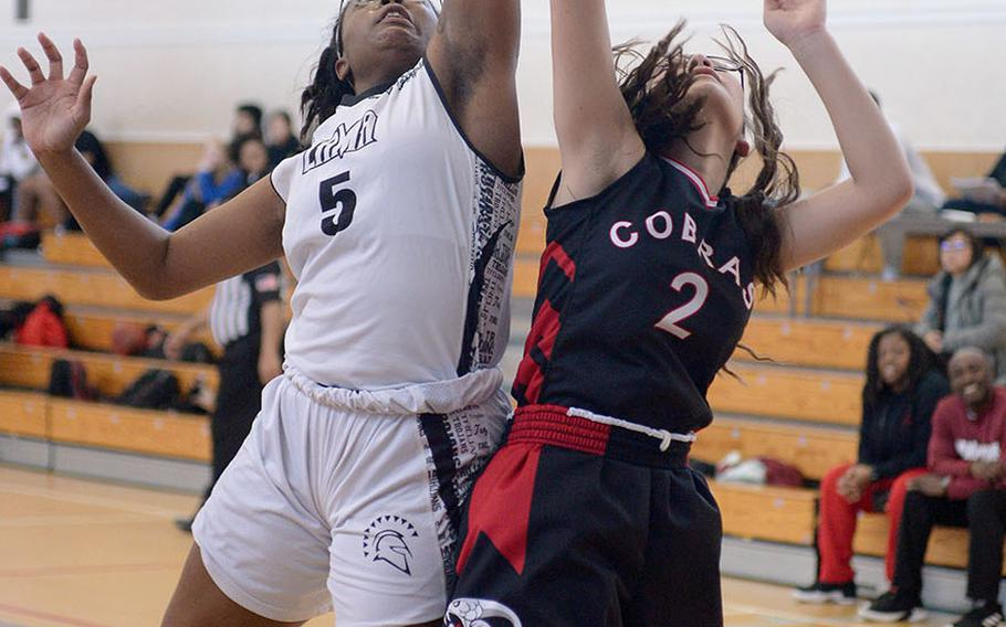 Zaman's Jalina Colar and E.J. King's Aileen Fitzgerald leap for a rebound.