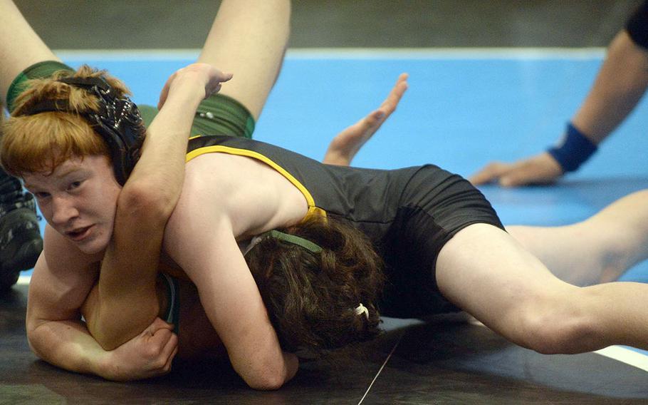 Kadena's Aiden Russell pins Kubasaki's Noah Vasquez in a 108-pound semifinal bout.