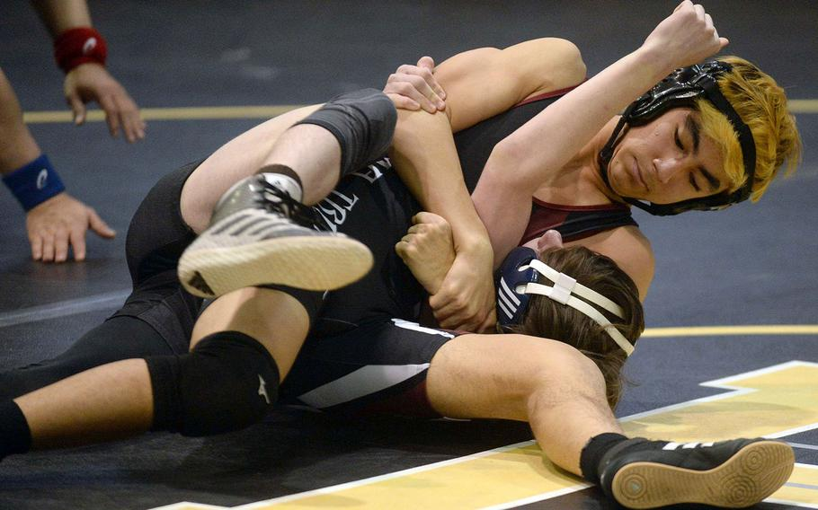 Zama's Kaito Hayashi pins Perry's Marcus Irons in a 122-pound semifinal victory.