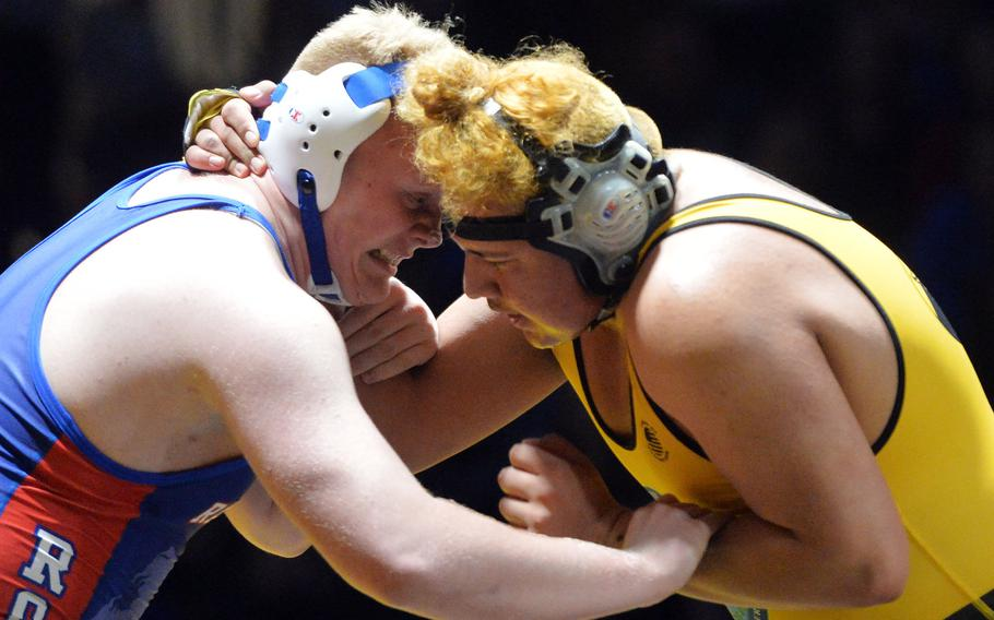 Ramstein's Theodore Ward, left, and Stuttgart's Danny Rodriguez-De Lao try to get the advantage in the 285-pound match at the DODEA-Europe wrestling finals in Wiesbaden. Germany, Saturday, Feb. 15, 2020. Ward prevailed to capture the 2020 title.