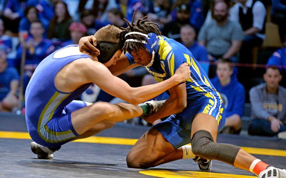 Sigonella's Amari Pyatt tries to bring down Wiesbaden's Jimmy Birchfield on his way to winning the 170-pound final at the DODEA-Europe wrestling finals in Wiesbaden. Germany, Saturday, Feb. 15, 2020.