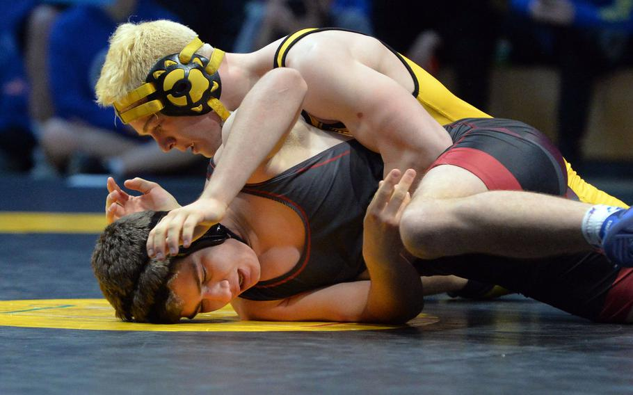 Stuttgart's Christian Just, top, defeated Ankara's Roberts Swart in the 160-pound match at the DODEA-Europe wrestling finals in Wiesbaden. Germany, Saturday, Feb. 15, 2020.