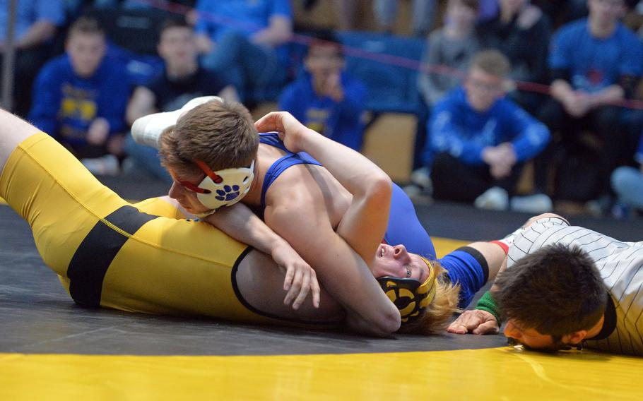 Ramstein's Christian Griffith goes for the win in the 138-pound title match against Stuttgart's Carter Hanes at the DODEA-Europe wrestling finals in Wiesbaden, Germany, Saturday, Feb. 15, 2020.