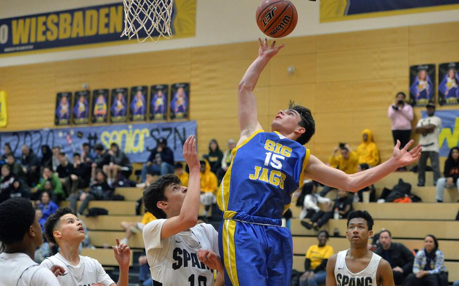 Sigonella's Jeremy Reardon shoots over Spangdahlem's Alden Vasquez  in a Division III game at the DODEA-Europe basketball championships in Wiesbaden, Germany, Wednesday, Feb. 19, 2020. The Sentinels beat the Jaguars 71-36.