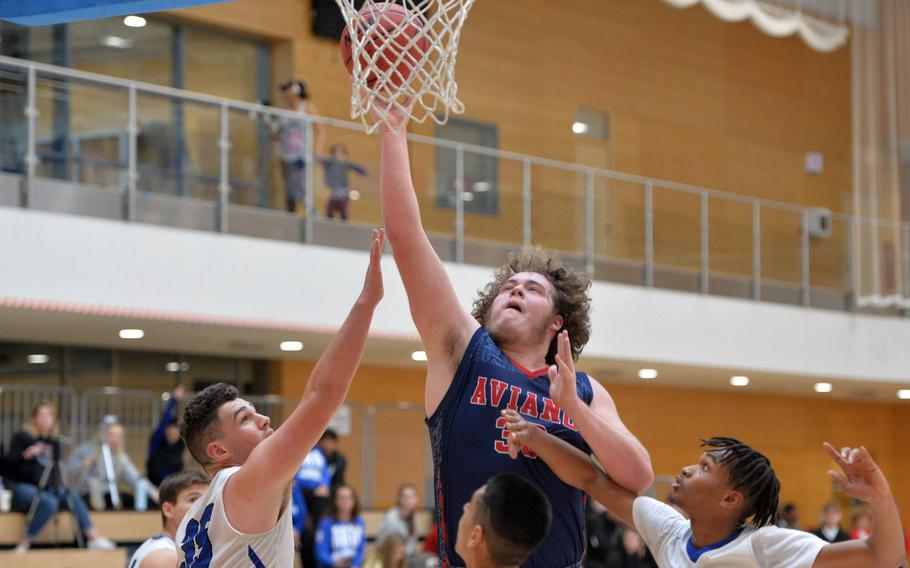 Aviano's Ben Broome goes to the hoop against the Rota defense in a Division II game at the DODEA-Europe basketball championships in Wiesbaden, Germany, Wednesday, Feb. 19, 2020. Aviano won 48-39.