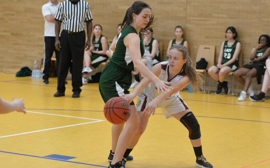 AFNORTH's Katelyn Eidson passes to a teammate as she is defended by Ankara's Milla Brown  in a Division III game at the DODEA-Europe basketball championships in Wiesbaden, Germany, Wednesday, Feb. 19, 2020. AFNORTH won 48-9.
