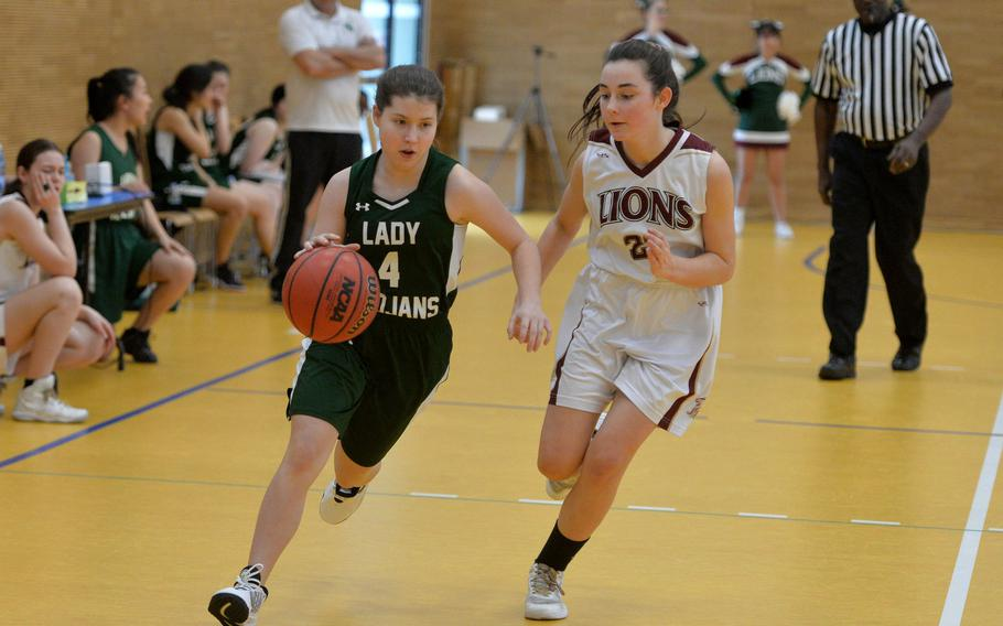 Ankara's Emma Brunick drives up the court against AFNORTH's Paula Bohlen  in a Division III game at the DODEA-Europe basketball championships in Wiesbaden, Germany, Wednesday, Feb. 19, 2020. AFNORTH beat Ankara 48-9.