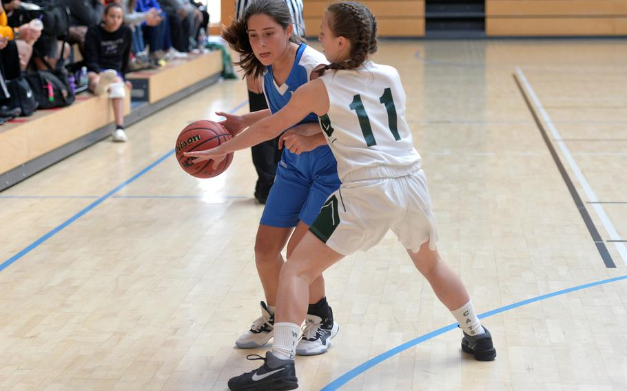 Marymount's Sofia Lopez drives against Naples' Emma Kasparek in a Division II game at the DODEA-Europe basketball championships in Wiesbaden, Germany, Wednesday, Feb. 19, 2020. Naples won 48-13.