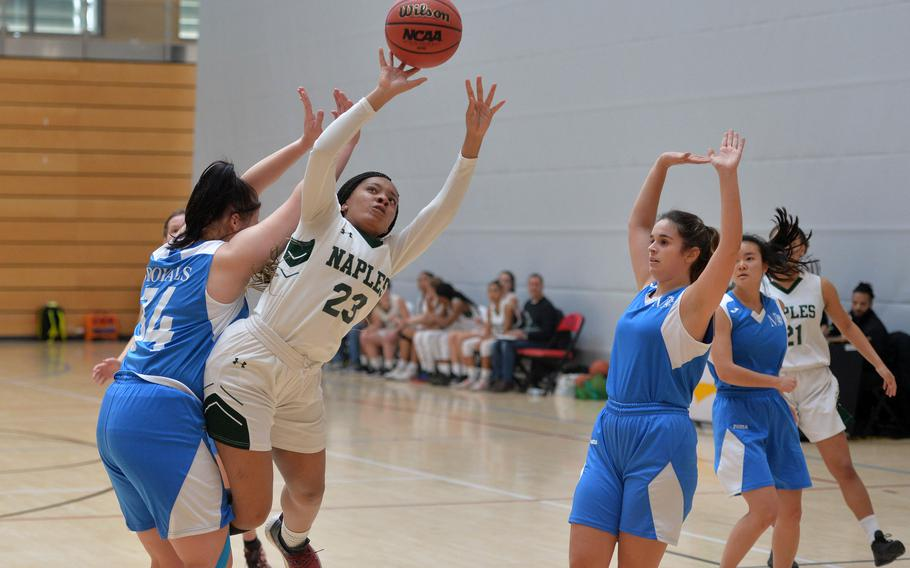 Naples' Dasia Greely scores an off-balance basket against Marymount's Anna Aboltina in a Division II game at the DODEA-Europe basketball championships in Wiesbaden, Germany, Wednesday, Feb. 19, 2020. Naples won 48-13.