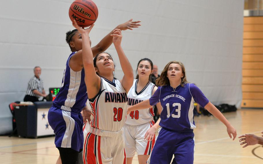 Aviano's Allana Vasquez gets past Bahrain's Kennedy Sawyer in a Division II game at the DODEA-Europe basketball championships in Wiesbaden, Germany, Wednesday, Feb. 19, 2020. Aviano won the game 30-12.