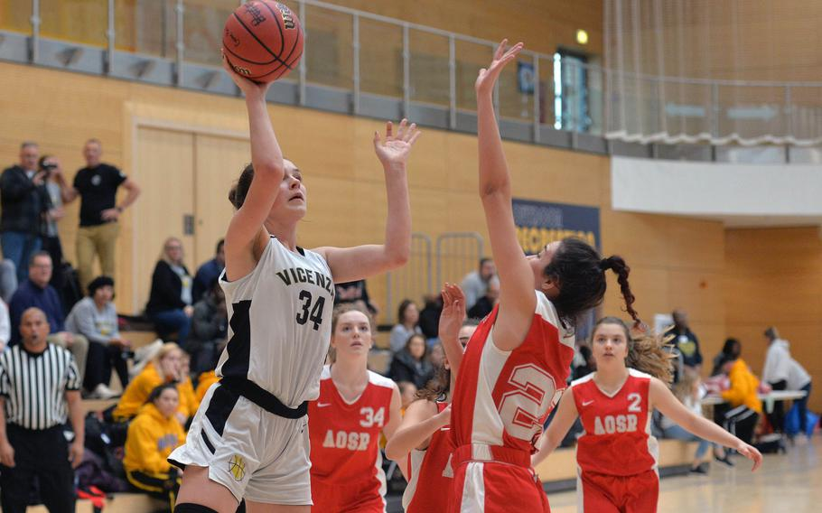 Vicenza's Claire Troiano shoots over AOSR's Maria Rossi in a Division II game won by Vicenza 42-36, at the DODEA-Europe basketball championships in Wiesbaden, Germany, Wednesday, Feb. 19, 2020.