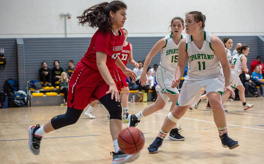 Kaiserslautern's Audrey Elisondo dribbles down the court during a game against SHAPE during the DODEA-Europe 2020 Division I basketball playoffs at the Southside gym on Ramstein Air Base, Germany, Wednesday, Feb. 19, 2020.