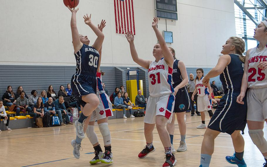 Black Forest Academy's Elisa DiGena takes a shot during a game against Ramstein during the DODEA-Europe 2020 Division I basketball playoffs at the Southside gym on Ramstein Air Base, Germany, Wednesday, Feb. 19, 2020.