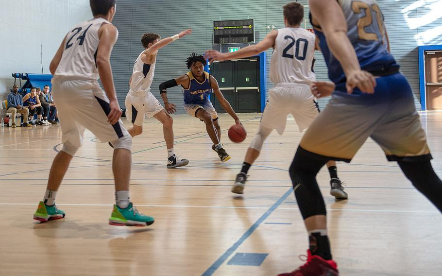 Wiesbaden's Darnell Moran Jr.drives to the basket during a game against Black Forest Academy during the DODEA-Europe 2020 Division I basketball playoffs at the Southside gym on Ramstein Air Base, Germany, Wednesday, Feb. 19, 2020.