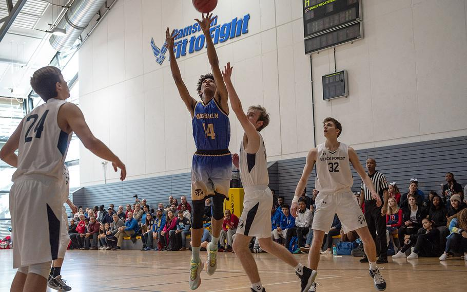 Wiesbaden's Dom Bivins takes a shot during a game against Black Forest Academy during the DODEA-Europe 2020 Division I basketball playoffs at the Southside gym on Ramstein Air Base, Germany, Wednesday, Feb. 19, 2020.