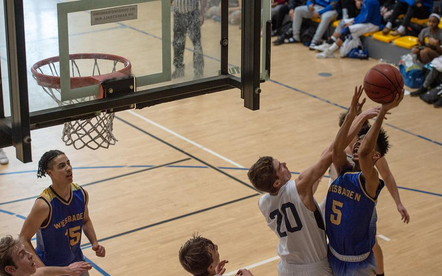 Wiesbaden's Kaleb McKenzie takes a shot during a game against Black Forest Academy during the DODEA-Europe 2020 Division I basketball playoffs at the Southside gym on Ramstein Air Base, Germany, Wednesday,  Feb. 19, 2020.