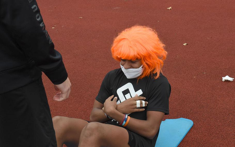 Vilseck's Aveion Ruffin, center, conducts sit-ups while showing off his Halloween spirit during the European Athletic Fitness Games championships at Vilseck, Germany on Saturday, Oct. 31, 2020.