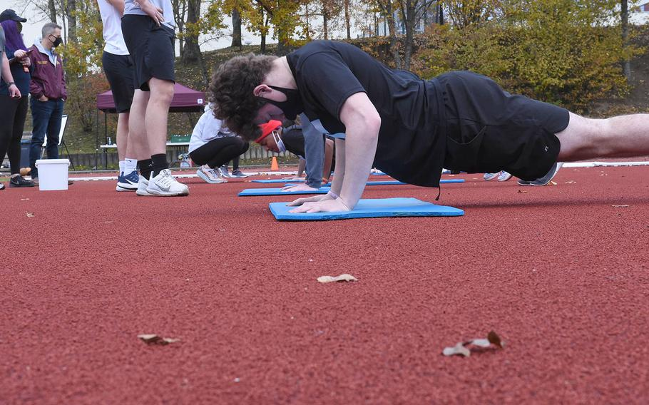 Vilseck's Nicolas Holcomb, right, participates during the pushups event at the European Athletic Fitness Games championships at Vilseck, Germany on Saturday, Oct. 31, 2020.