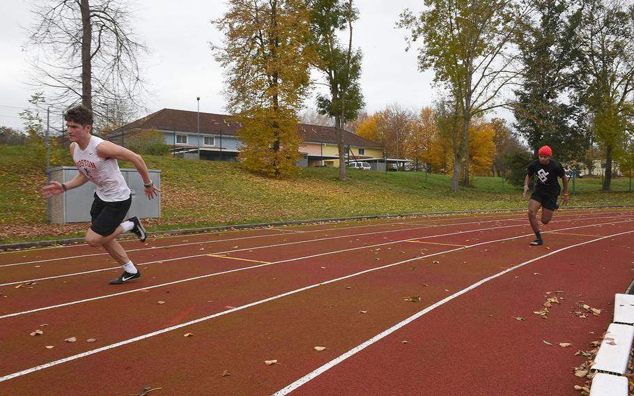 Vilseck's Jacob Rathburn, left, and Aveion Ruffin take off during the 200-meter event at the European Athletic Fitness Games championships at Vilseck, Germany on Saturday, Oct. 31, 2020.