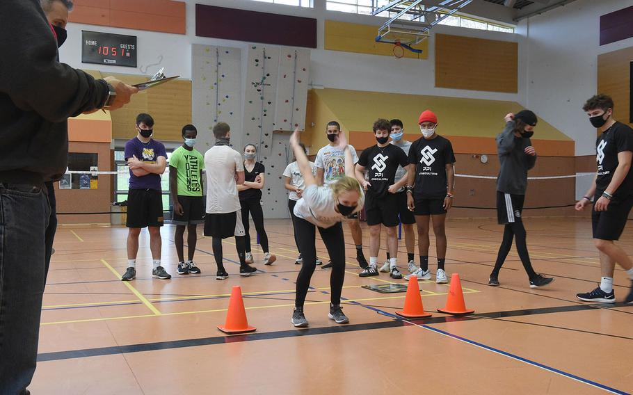 Vilseck's Dakota Reece prepares to jump during the standing broad jump event at the European Athletic Fitness Games championships at Vilseck, Germany on Saturday, Oct. 31, 2020.