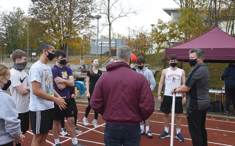Coach Brian Swenty, right, speaks to competitors before the start of the European Athletic Fitness Games championships at Vilseck, Germany on Saturday, Oct. 31, 2020.