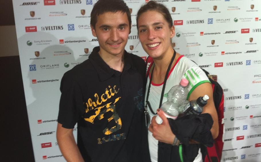 DODDS-Europe tennis champion Ajdin Tahorovic of Patch High School and German pro Andrea Petkovic get together at the recent Porsche Open tennis tournament in Stuttgart, Germany. Both players are of Bosnian descent.