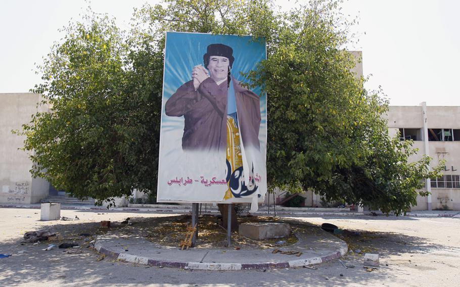 A portrait of Moammar Gadhafi is seen in the entrance courtyard of Abu Salim prison in Tripoli, Libya on Saturday.