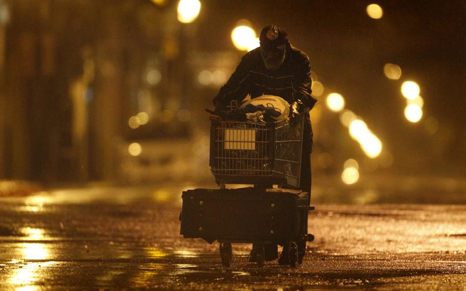 Lenard Sanders, a homeless man, pushes his cart toward a subway station to seek shelter as Hurricane Irene makes its way along the Eastern Seaboard, Sunday in Philadelphia. The National Hurricane Center says a hurricane warning remains in effect from coastal Virginia northward to Sagamore Beach, Mass.