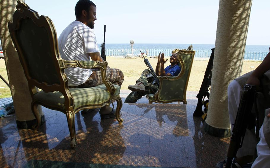 Libyan rebels from Misrata take a rest Sunday in the camp set up in Gadhafi's wife Safiah's summer abandoned home  in Tripoli, Libya.
