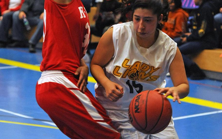 Heidelberg's Rebecca Luna drives against Jada Perry of Kaiserslautern in the Lady Lions' 38-36 win over the visiting Raiders on opening day of the 2011-12 DODDS-Europe basketball season Friday night.