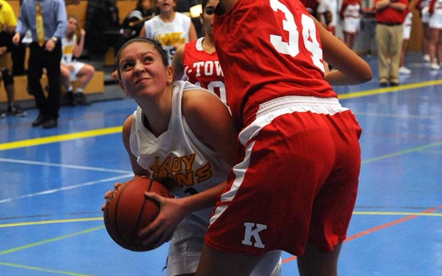 Heidelberg's Aileen Donnelly, left, looks to get off a shot against  Kaiserslautern's Angela Powell in Heidelberg's 38-36 win over the Raiders on opening day of the 2011-12 DODDS-Europe basketball season in Heidelberg, Friday night.