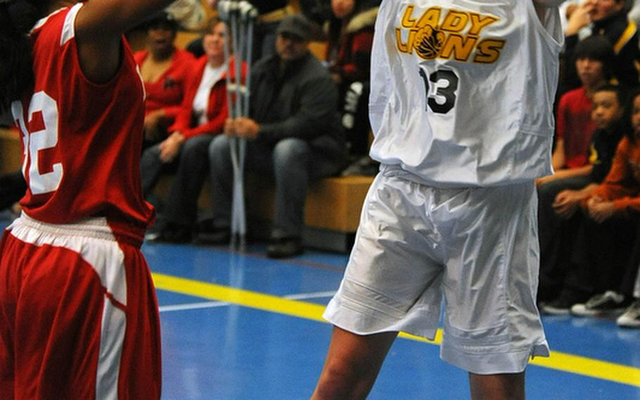 Heidelberg's Marlowe Muehlbauer, right, gets the game-winning shot off over Kaiserslautern's Medina Gregory as time runs out in opening day action of the 2011-12 DODDS-Europe basketball season in Heidelberg, Friday night. Heidelberg won 38-36.