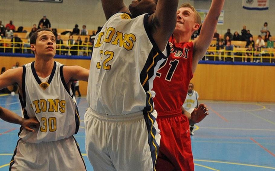 Heidelberg's Mezzan El Sayed gets past Kaiserslautern's Andrew Stern as teammate Marcel SImon watches in opening day action of the 2011-12 DODDS-Europe basketball season in Heidelberg on Friday night.