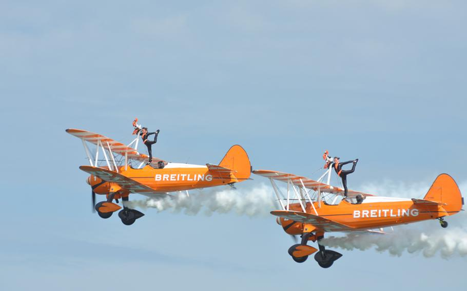 Two women with no fear of heights balance on top planes during an air show in Jesolo, Italy, last summer.