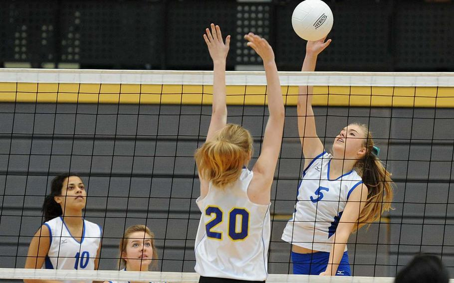 Rota's Tiffani Driscoll hits the ball over the net as Bamberg's Caoimhe Harvey defends. Rota beat Bamberg 25-5, 25-13 in a Division III quarterfinal at the DODDS-Europe volleyball championships.