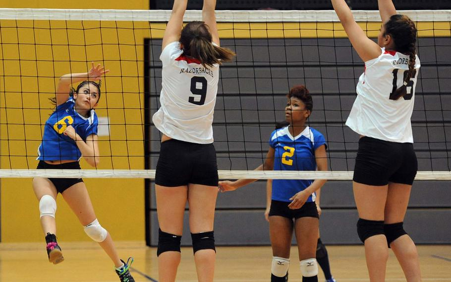 Ansbach's Jasmine Rodriguez watches her shot sail between the defense of Schweinfurt's Tricia Valverde, left, and Maria Maika, as teammate Caprice Lockett watches in a Division II match at the DODDS-Europe volleyball championships. Ansbach won the match 25-22, 25-9.