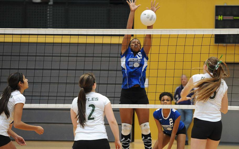 Tashia Golson of Hohenfels goes high to block a Naples return in a Division II match at the DODDS-Europe volleyball championships as Isabel Krause, Logan Percival and Tara O'Brien of Naples and Ariana Hannah of Hohenfels watch.  Naples won the match 25-12, 25-11.