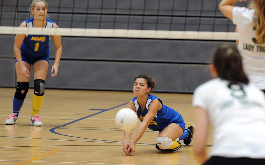 Sigonella's Allison Cruz digs deep to return an Ankara serve in a Division III quarterfinal match at the DODDS-Europe volleyball championships. The Jaguars beat Ankara 25-20, 25-12 to advance to the semifinals against Alconbury.