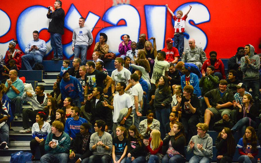 The crowd reacts to a good play Friday night as their Ramstein Royals defeated the visiting Vilseck High School Falcons at Ramstein Air Base.