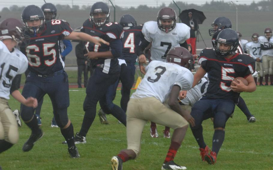 Bitburg running back Kenny Love crosses the goal line before Baumholder's Isaiah Wilson can apply a hit Saturday at Bitburg, Germany. Bitburg won the game 42-6 and set a new DODDS-Europe record with its 32nd consecutive victory.