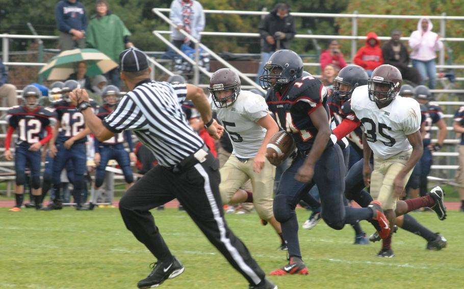 Bitburg running back Larry Jackson breaks free for a 57-yard second-quarter touchdown run against Baumholder on Saturday at Bitburg, Germany. Bitburg won the game 42-6 and set a new DODDS-Europe record with its 32nd consecutive victory.