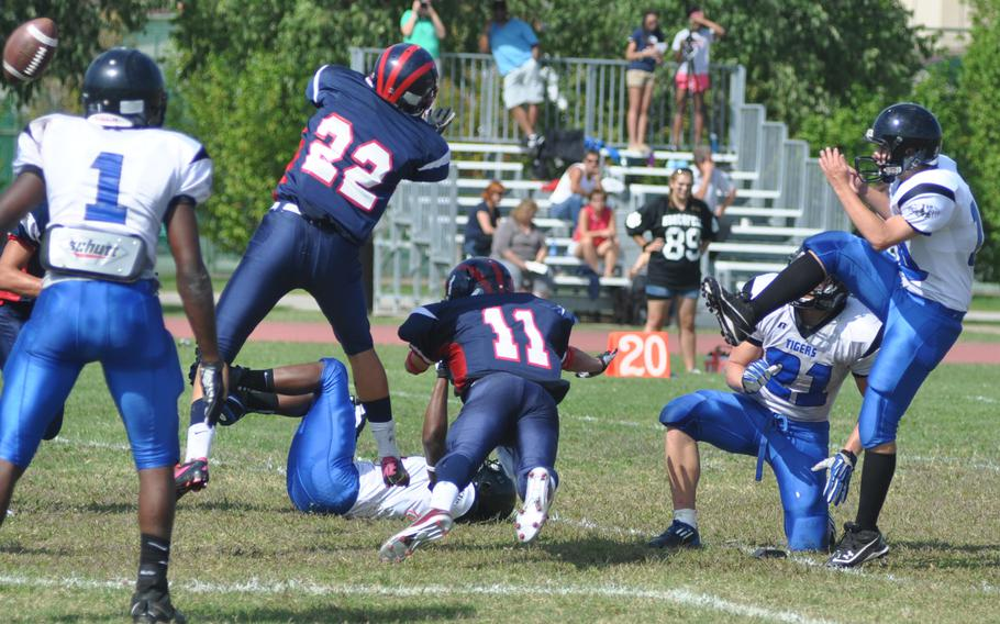 Aviano's Daniel Dinges and Ryan Perran attempted to block a field goal by Hohenfels during a game Saturday at Aviano Air Base, Italy. Hohenfels won 41-22.