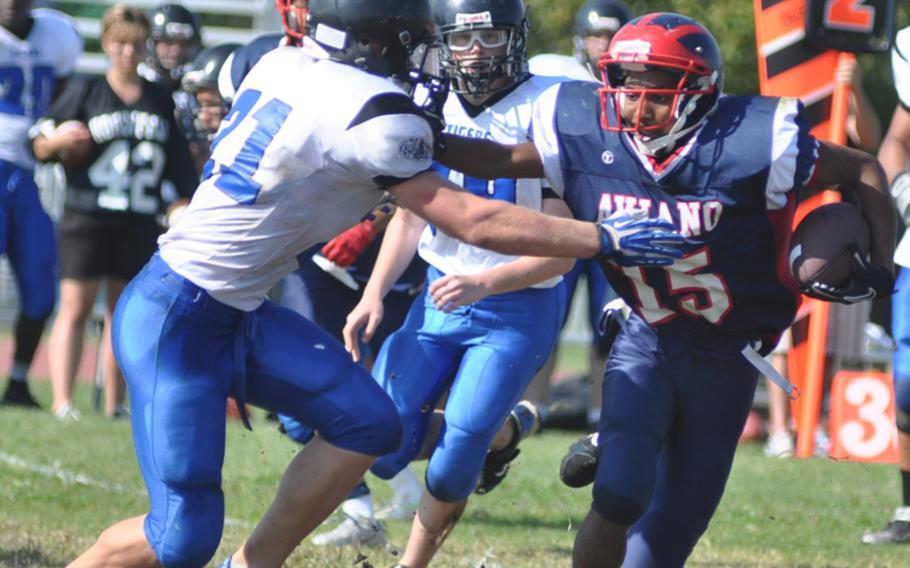 Aviano's Te'Kevin Boston tries to push by Hohenfels' David Vidovic during a game Saturday at Aviano Air Base, Italy. Hohenfels won 41-22.