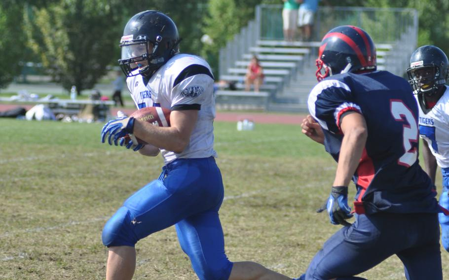 Hohenfels' David Vidovic runs past Aviano's Mike Trujillo to score one of his four touchdowns during Saturday's game at Aviano Air Base, Italy. Vidovic rushed 15 times for 198 yards and had one reception for 79 yards, leading Hohenfels to win 41-22.