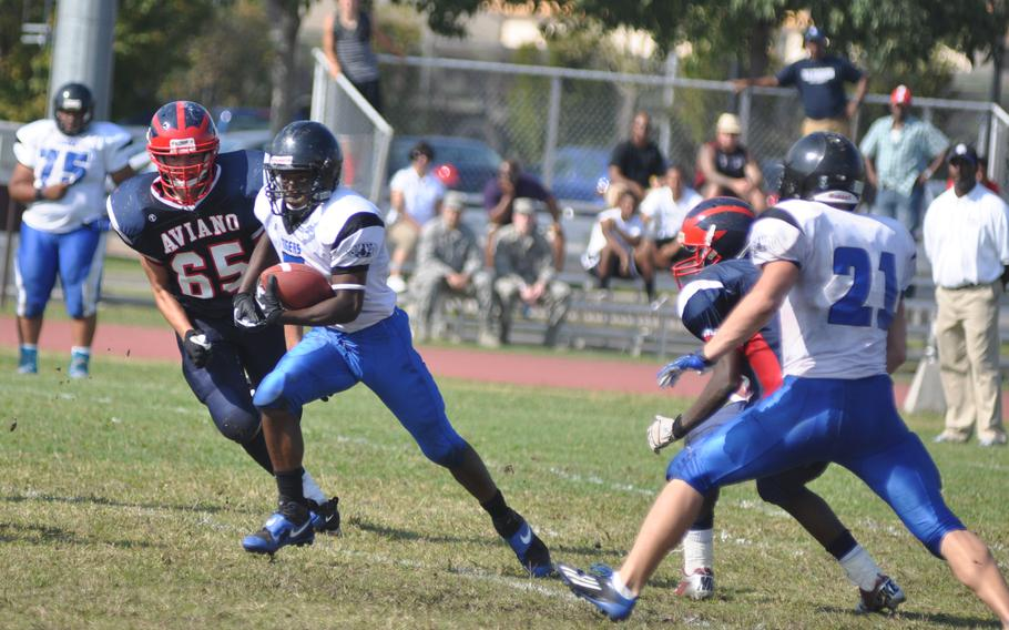 Hohenfels' Marcus Dudley Jr. runs past Aviano's Lino Zanussi during Saturday's game at Aviano Air Base, Italy. Dudley ran 45 yards and scored a touchdown off an interception assisting Hohenfels in a 41-22 win.