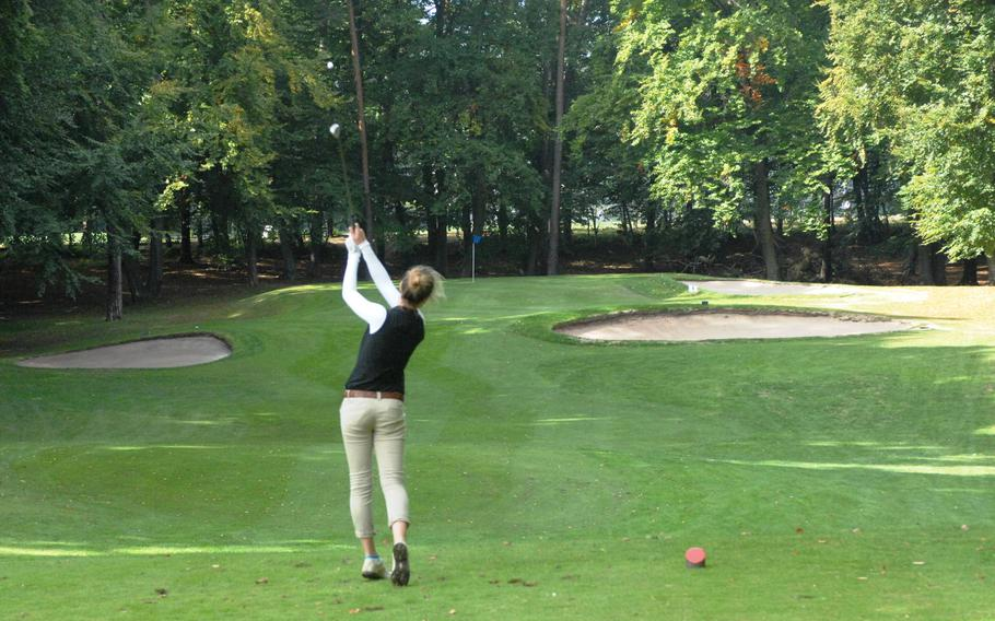 Patch golfer Meredith Stuber watches her tee shot on the par-three 10th hole Thursday at Woodlawn Golf Course at Ramstein Air Base, Germany.