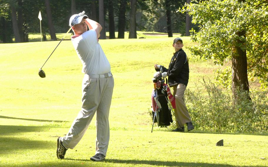 Kaiserslautern golfer Jeffery Kidwell tees off as Patch freshman Jordan Holifield watches Thursday at Woodlawn Golf Course at Ramstein Air Base, Germany.