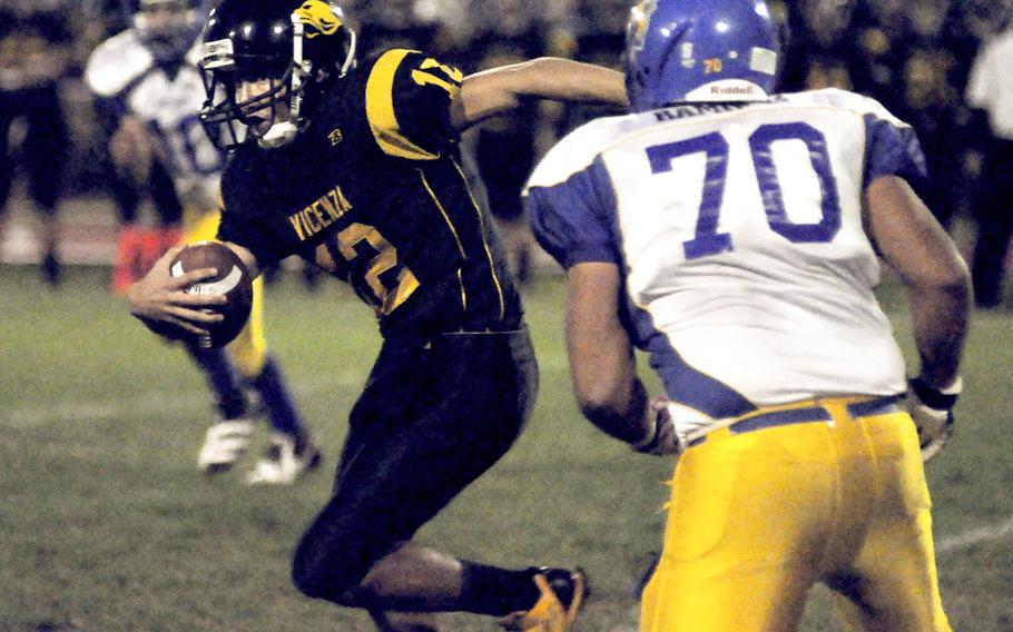 Vicenza quarterback Mario Molina tries to elude Ansbach's Miguel Ramirez on Friday night. Ansbach won the game 25-6 and stayed unbeaten to finish the regular season.