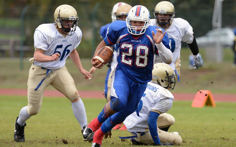 Ramstein's Tevin Johnson gets past a bevy of Wiesbaden defenders on his way to the end zone in the Royals' 20-7 win over the visiting Warriors Saturday, Oct. 12, 2013.
