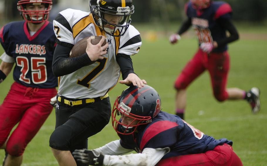 Patch freshman Holten Sparling attempts to run past a Lakenheath defender Saturday, Oct. 19, 2013, during a game at RAF Lakenheath, England. Patch won 28-27 and will advance to the European Division I semifinals.